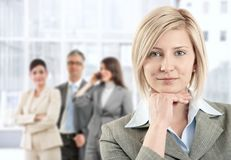 Smiling Businesswoman With Team Stock Image