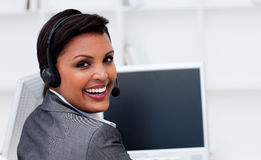 Smiling businesswoman at work Royalty Free Stock Photos