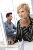 Smiling businesswoman at work Royalty Free Stock Image