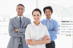 Smiling businesswoman with work colleagues Stock Photography