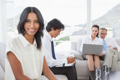 Smiling businesswoman with work colleagues Royalty Free Stock Image
