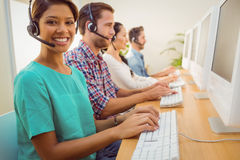 Smiling businesswoman working in a call centre Royalty Free Stock Image