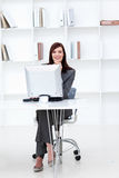 Smiling businesswoman working at a computer Stock Photo
