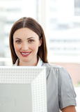Smiling businesswoman working at a computer Royalty Free Stock Photography