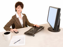 Smiling Businesswoman Working at a Computer Royalty Free Stock Photos