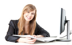 Smiling businesswoman working with a computer and documents Stock Photography