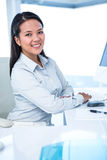 Smiling businesswoman working on computer Royalty Free Stock Photo