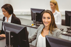 Smiling businesswoman working in computer room Stock Photography