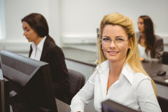 Smiling businesswoman working in computer room Royalty Free Stock Image