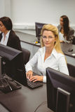 Smiling businesswoman working in computer room Royalty Free Stock Images