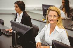 Smiling businesswoman working in computer room Stock Image