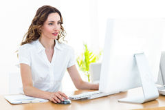 Smiling businesswoman working with computer Stock Photos