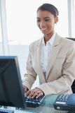 Smiling businesswoman working on her computer Royalty Free Stock Photography