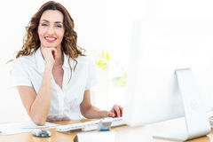 Smiling businesswoman working with her computer Royalty Free Stock Photography