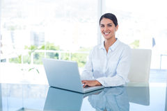 Smiling businesswoman working with her laptop Royalty Free Stock Photo