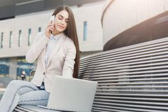 Caucasian businesswoman working with laptop outdoors Royalty Free Stock Photography