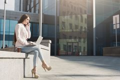 Caucasian businesswoman working with laptop outdoors Stock Image