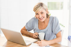 Smiling businesswoman working on a laptop Royalty Free Stock Image