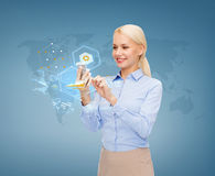 Smiling businesswoman working with smarthphone Stock Image