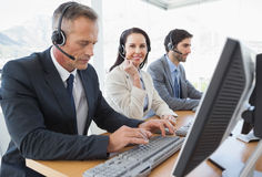 Smiling businesswoman working with teammates Stock Photo