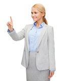 Smiling businesswoman working with virtual screen Stock Photography
