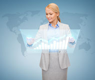 Smiling businesswoman working with virtual screen Royalty Free Stock Photos