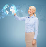 Smiling businesswoman working with virtual screen Royalty Free Stock Images