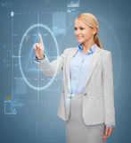 Smiling businesswoman working with virtual screen Royalty Free Stock Photography