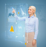 Smiling businesswoman working with virtual screen Royalty Free Stock Image