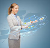 Smiling businesswoman working with virtual screen. Business, future, technology and people concept - smiling young businesswoman working with virtual screen Royalty Free Stock Image