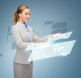 Smiling businesswoman working with virtual screens. Business, future and technology concept - young businesswoman working with virtual screens Royalty Free Stock Photography