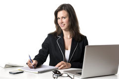 Smiling businesswoman writing something Royalty Free Stock Image