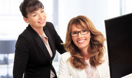 Smiling businesswomen with computer royalty free stock images