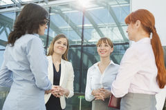 Smiling businesswomen conversing in office Royalty Free Stock Photo