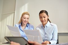 Smiling businesswomen meeting in office Stock Images
