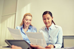 Smiling businesswomen meeting in office Stock Photos
