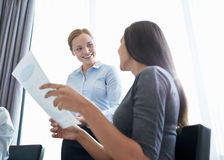 Smiling businesswomen meeting in office Stock Image