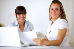 Smiling businesswomen reading documents Royalty Free Stock Photography