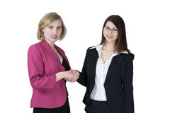 Smiling businesswomen shake hands Stock Photography