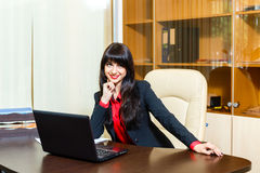 Smiling businesswomen sitting at the table in the office Royalty Free Stock Images