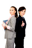 Smiling businesswomen with thumbs up. Stock Photo