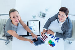 Smiling businesswomen working together Royalty Free Stock Image