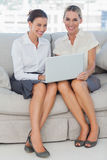 Smiling businesswomen working together posing Stock Photos