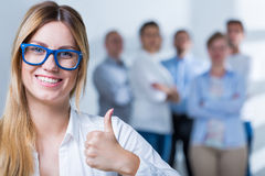 Smiling busineswoman showing thumb up Stock Images