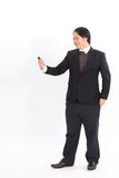 Smiling bussiness man looking at his smart phone Stock Image