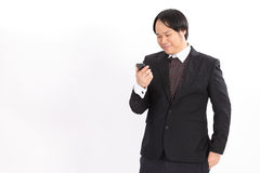 Smiling bussiness man looking at his smart phone Royalty Free Stock Photo