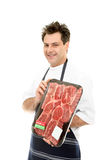 Smiling Butcher. Holding meat tray Royalty Free Stock Photo