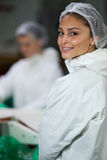 Smiling butcher standing in meat factory Royalty Free Stock Photography