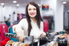 Smiling buyer at clothing store Royalty Free Stock Photos
