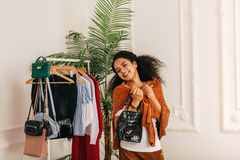 Smiling buyer with eyes closed. Standing at wardrobe royalty free stock photos